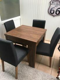 Next dining room table and 4 chairs