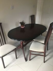 Wooden table with 4 chairs for sale in good condition