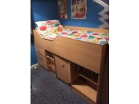 Sturdy cabin bed including pullout desk, drawers and shelves