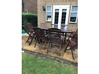 large solid wood table and 10 folding reclining chairs with cushions