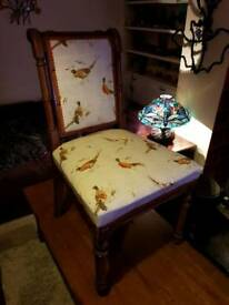 A pair of reupholstered antique chairs. Stunning