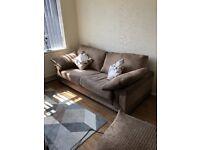 Three seater brown sofa