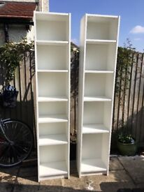 Two white book cases