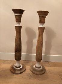 Pair of tall floor standing wooden pillar candlestick holders