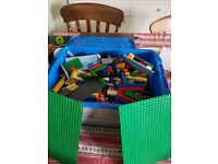 Big box of lego with 2x green boards.