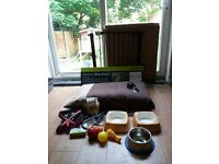 Dog stuff: brand new or less than 2 weeks old! Dog gates, bed, car guard, training leads and more..