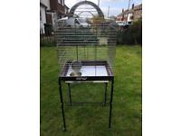 Bird cage on a nice stand on wheels