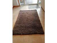 Taupe shag pile rug