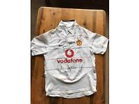 Manchester United 2003/2004 children's away shirt autographed.
