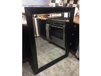 Large black high gloss mirror