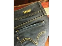 Fabulous LEVI limited edition black label skinny jeans with metallic gold stitching size 30x34