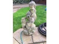 Pond statue with hose