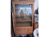 Pine display cabinet with glass doors and two drawers