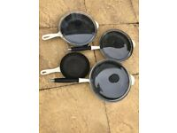 Le Creuset pots and frying pans - well loved