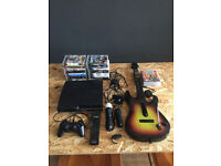 PS3 console bundle + Guitar Hero + Playstation Move + 22 games + Controller