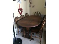 Oak table, six chairs and carver £50