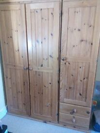 Triple pine wardrobe . L 132cm x H 176cm (approx). Comes apart in 3 sections