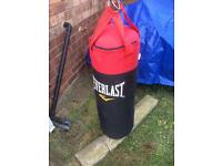 Boxing punch bag, pads and gloves