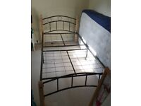 Single 3ft bed frame in mix of black metal and wood.