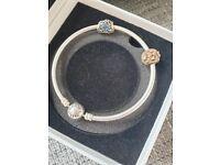 Genuine pandora bracelet with 2 charms