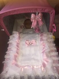 Pink and blue silver cross dolls pram ( excellent condition) never been played with or took outside