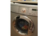LG direct drive washing machine in silver