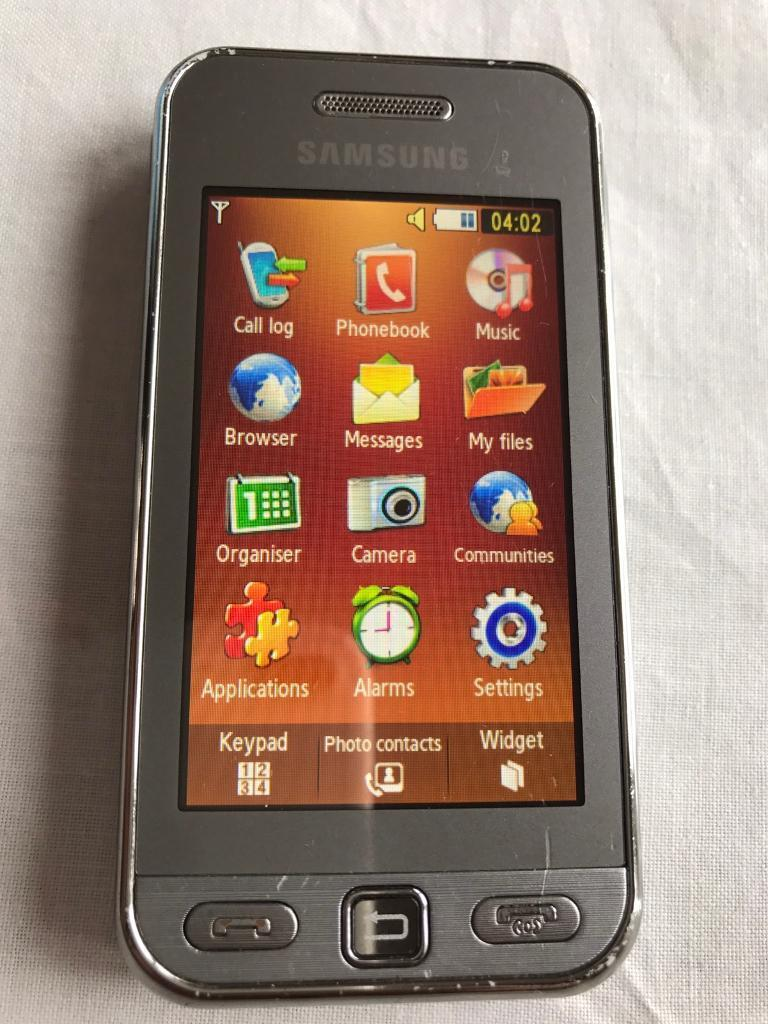 Samsung tocco lite mobile phone on Vodafone with charger and headphone