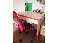 Pink and white child's desk and chair