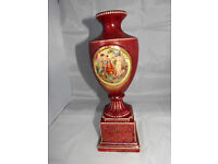 red vintage vase with picture scene of girls in garden in gilt oval