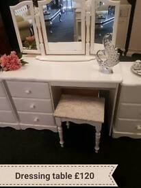 Dressing table has stool and mirror