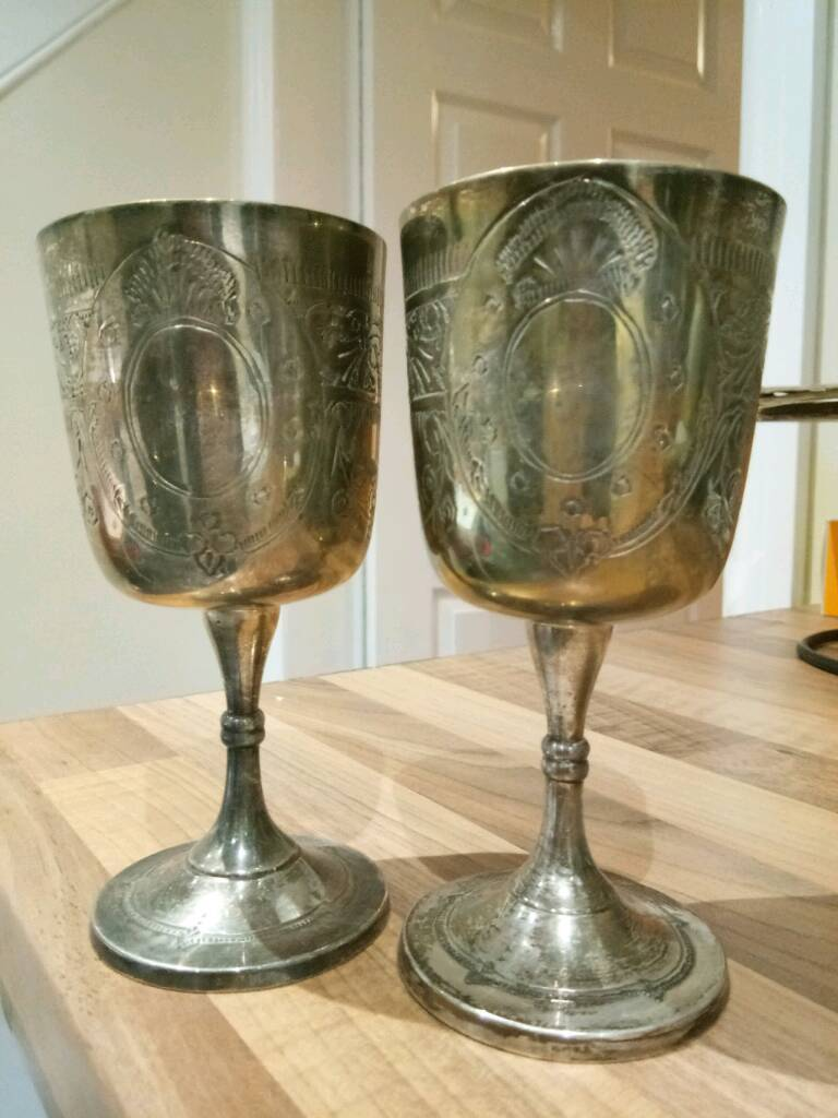 Pair of engraved, vintage silver plated wine goblets.