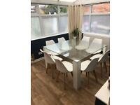 Large glass dining table seats 8 (chairs not included)