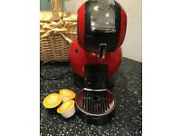 DOLCE GUSTO RED COFFEE MACHINE. USED BUT IN GREAT CONDITION.