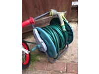 Garden hose on reel stand