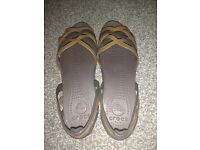 Size 8 bronze Crocs sandals