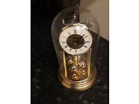 domed glass carriage mantel clock