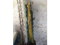 Electric fence posts and guides