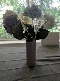 Plastic flowers and ceramic vase