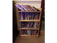 nearly 100 DVD's with rack