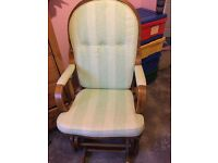 Gorgeous pine rocking chair with green cushions ideal for nursery