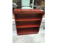 Solid bookcase , in good condition. Has 3 shelves .