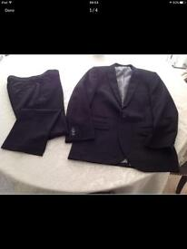Boys Black Suit (Blazer/Trousers) Next Blazer 13 years old. Trousers 12 Years old.