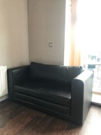 Black  leather 2 seater sofa-bed  in sale