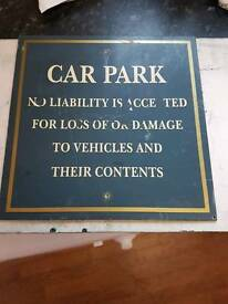 metal car park pub sign