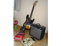 Fender squire strat guitar, amp, strap, digital tuner, plectrums and X4 books