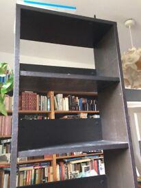 Tall narrow bookshelf.
