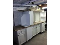White kitchen cabinets and storage units