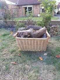 Wicker Basket and seasoned logs