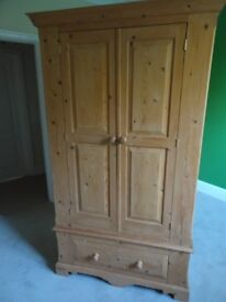 Double doored pine wardrobe with drawer