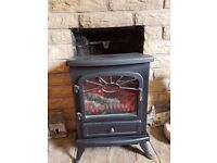 Electric fire - looks like a wood burning stove